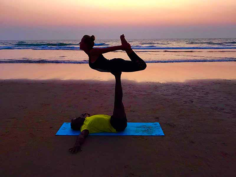 Sunset acro yoga on Mandrem Beach Goa